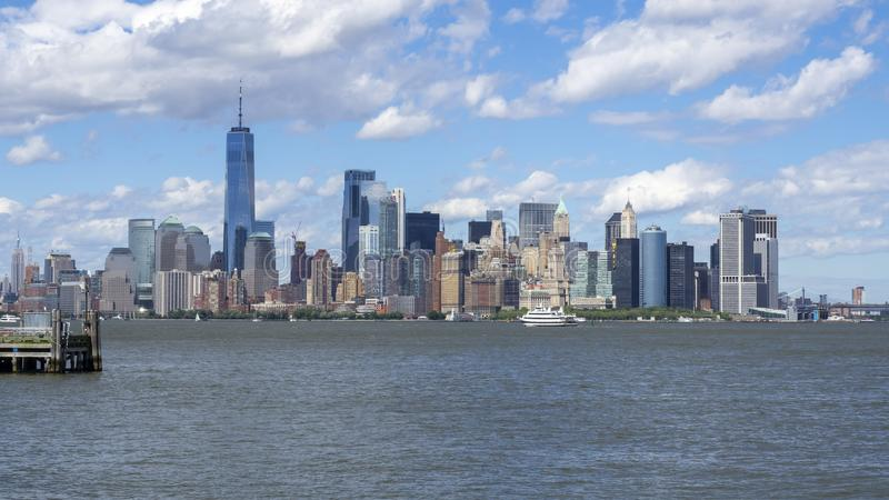 New York, NY, USA. Amazing skyline of Manhattan skyscrapers from Liberty Island - Statue of Liberty. Summer time royalty free stock photography