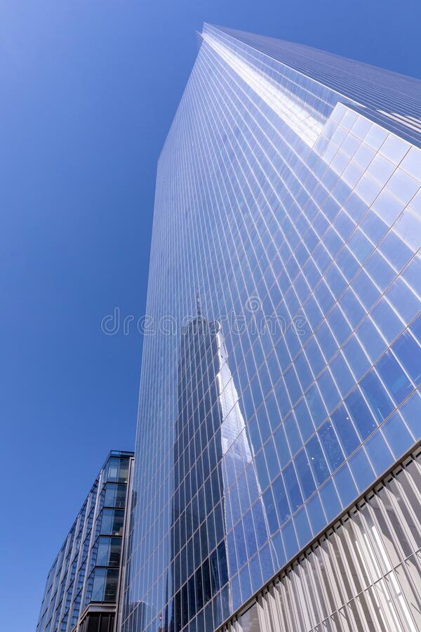 One World Trade Center skyscraper reflection on a side of Four World Trade Center building stock photo