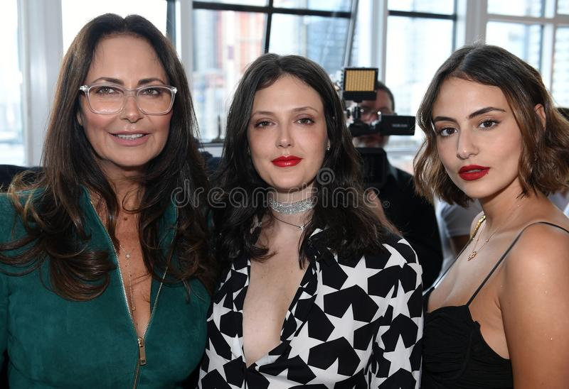 Designer Berta Balilti L and guests posing backstage before Berta Bridal 2018 Collection runway show. New York, NY, USA - October 6, 2017: Designer Berta Balilti stock photo