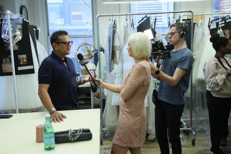 Designer Naeem Khan giving away interview backstage before the Naeem Khan Bridal 2018 Collection runway show. New York, NY, USA - October 6, 2017: Designer Naeem royalty free stock image