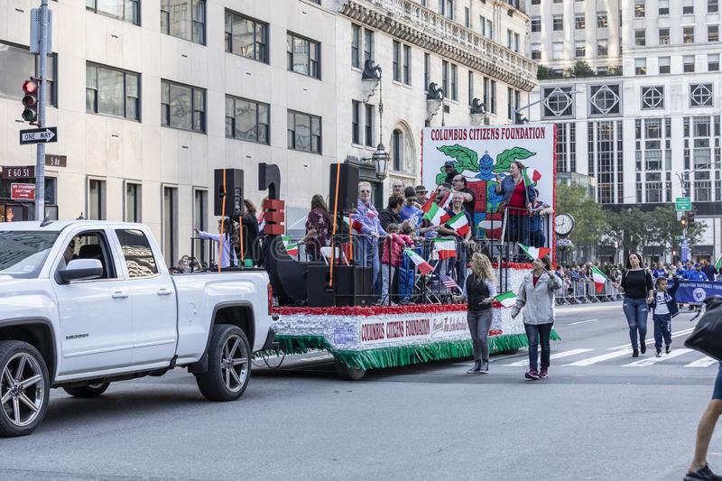 Columnbus Day Parade NYC 2019. New York, NY, USA - October 14, 2019: A float with people moves up Fifth Avenue during 75th Annual Columbus Day Parade, Manhattan stock images