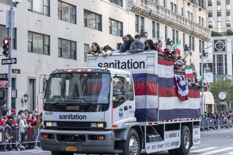 Columnbus Day Parade NYC 2019. New York, NY, USA - October 14, 2019: Sanitation trucks moves along Fifth Avenue during 75th Annual Columbus Day Parade, Manhattan stock photo