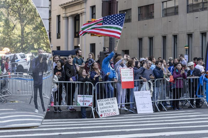 Columnbus Day Parade NYC 2019. New York, NY, USA - October 14, 2019: Spectators cheer NYFD members during 75th Annual Columbus Day Parade along a Fifth Avenue royalty free stock image