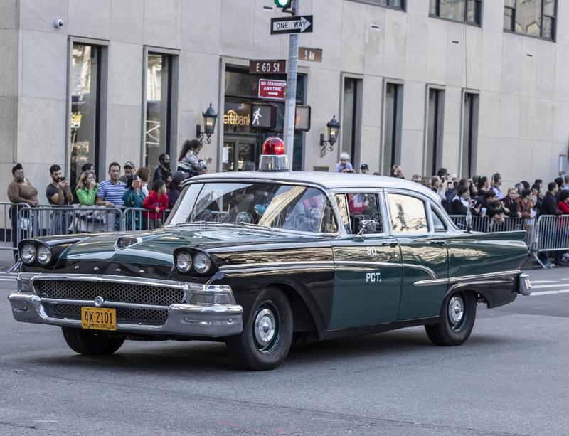 Columnbus Day Parade NYC 2019. New York, NY, USA - October 14, 2019: Vintage police car moves along Fifth Avenue during 75th Annual Columbus Day Parade royalty free stock images