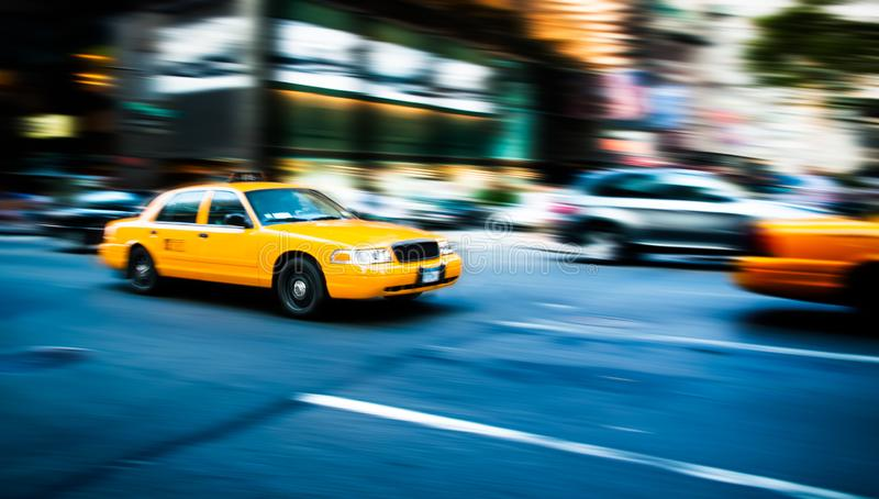 New York NYC yellow cab taxi traditional New York City fast movement with motion blur panning, in the busy streets of Manhattan. NEW YORK, USA - JUL 16,2010 royalty free stock images