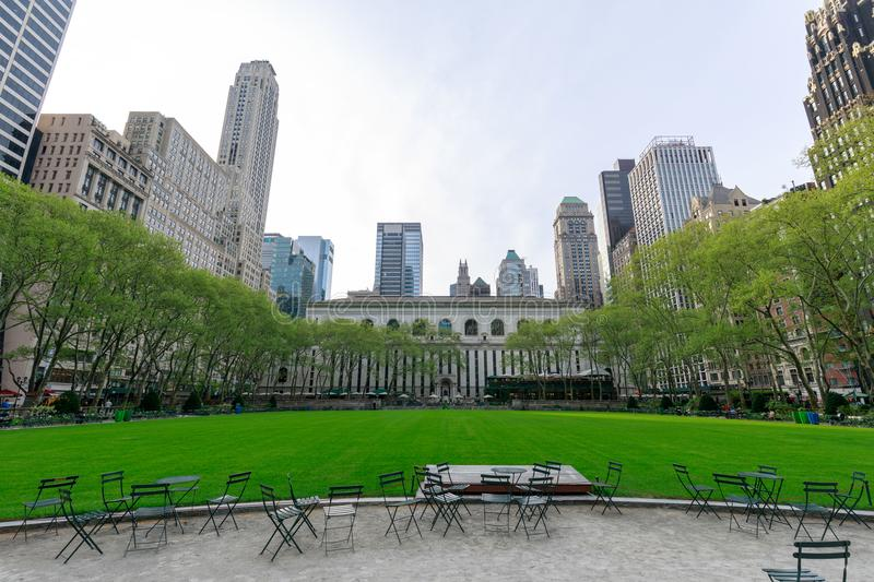 New York Public Library & Bryant Park in Midtown Manhattan, NYC. New York, USA - May 7, 2018 : New York Public Library & Bryant Park in Midtown Manhattan, NYC stock photos