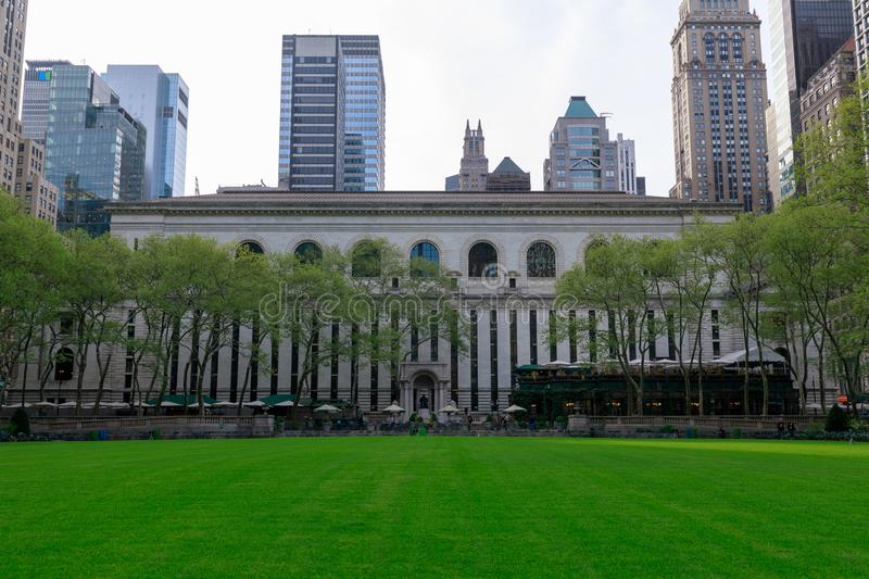 New York Public Library & Bryant Park in Midtown Manhattan, NYC. New York, USA - May 7, 2018 : New York Public Library & Bryant Park in Midtown Manhattan, NYC royalty free stock image