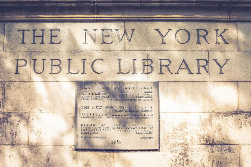 The New York Public Library plaque - Jefferson Market Branch. New York, USA - 27 September 2016: The New York Public Library plaque - Originally a courthouse stock photos