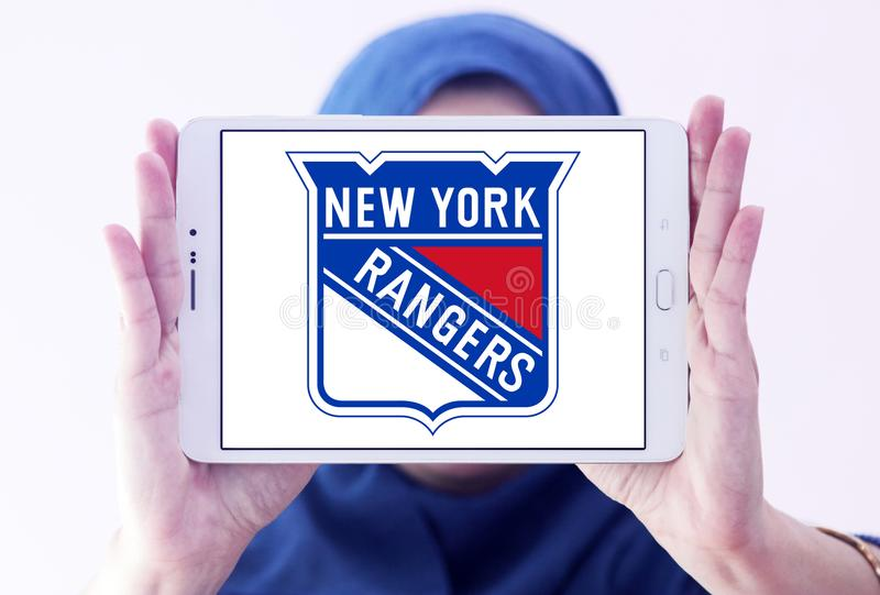 New york rangers ice hockey team logo. Logo of New York Rangers ice hockey team on samsung tablet holded by arab muslim woman. The New York Rangers are a royalty free stock photos