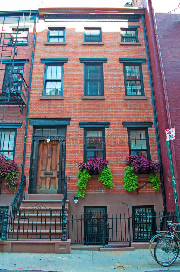 New York: red townhouses in Greenwich Village on September 15, 2014. Greenwich Village, referred to by locals as simply The Village, is a neighborhood on the royalty free stock photos