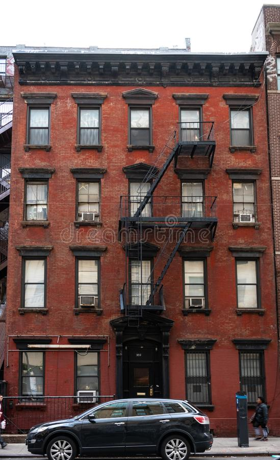 New York Residential flats. New York City, United States - November 17 2018: A typical block of New York Residential flats with external fire escape ladders on stock image