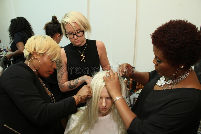 NEW YORK - SEPTEMBER 03: A model getting ready backstage for Victor de Souza Spring Summer 2015 presentation royalty free stock image