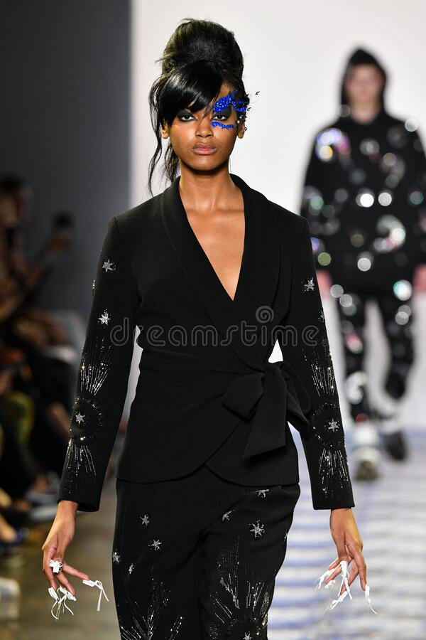 A model walks the runway for Libertine during New York Fashion Week. NEW YORK, NEW YORK - SEPTEMBER 11: A model walks the runway for Libertine during New York stock images