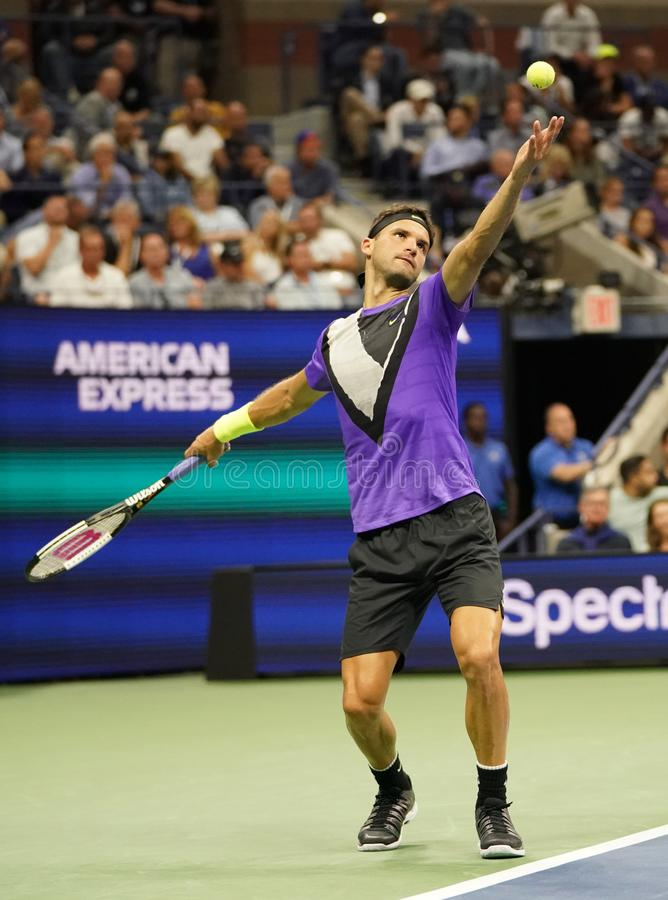 Grigor Dimitrov of Bulgaria in action during the 2019 US Open quarter-final match against 20-time Grand Slam champion Roger Federe royalty free stock photography