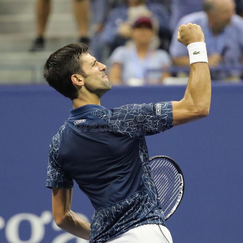 13-time Grand Slam champion Novak Djokovic of Serbia celebrates victory after his 2018 US Open semi-final match. NEW YORK - SEPTEMBER 7, 2018: 13-time Grand Slam royalty free stock photography