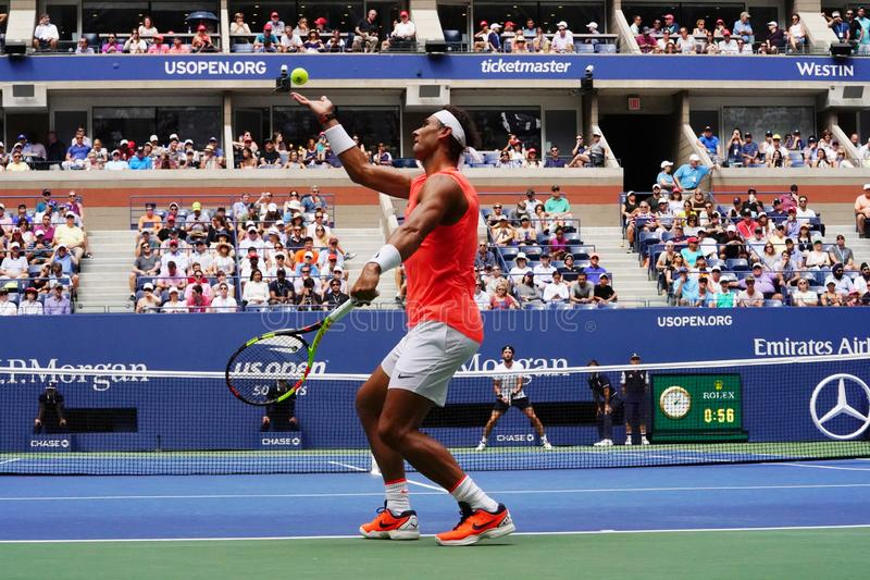 17-time Grand Slam champion Rafael Nadal of Spain in action during his 2018 US Open round of 16 match. NEW YORK - SEPTEMBER 2, 2018: 17-time Grand Slam champion royalty free stock photos