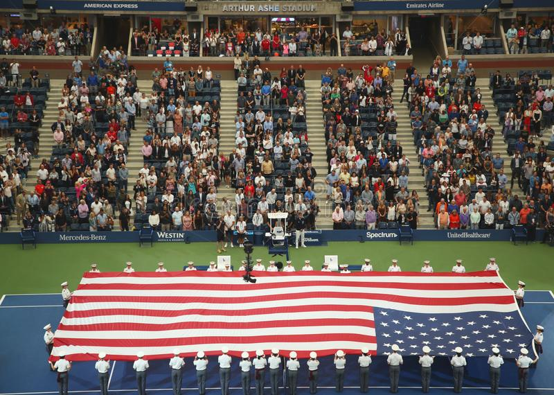 U.S. Military Academy at West Point cadets unfurling American Flag before the U.S. Open Men`s Tennis Final match. NEW YORK- SEPTEMBER 8, 2018: U.S. Military stock photo