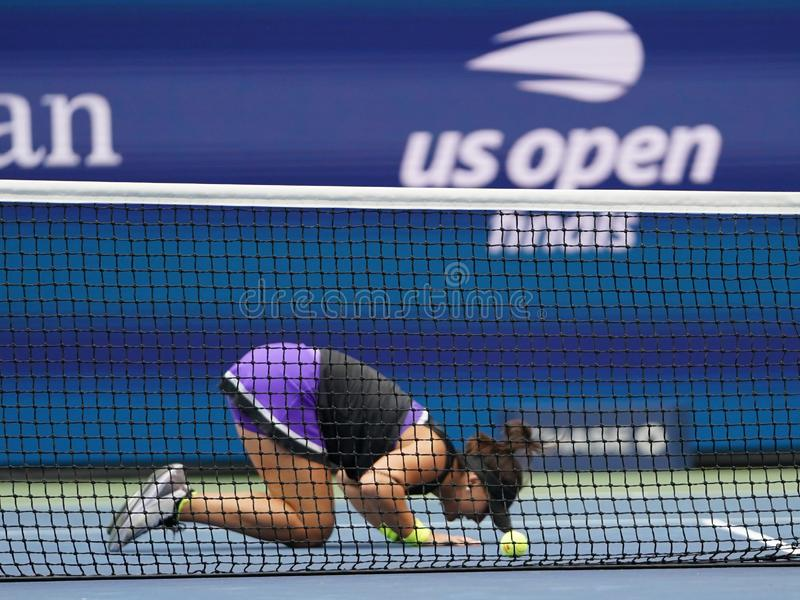 2019 US Open champion Bianca Andreescu of Canada celebrates winning her final match over Serena Williams. NEW YORK - SEPTEMBER 7, 2019: 2019 US Open champion royalty free stock photo