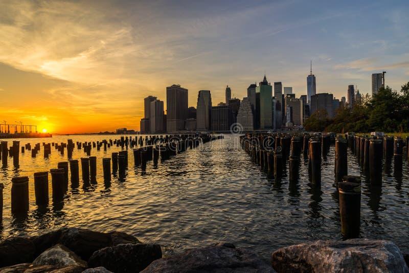 New York Skyline Cityscape Lower Manhatten World Trade Center Freedom Tower from Brooklyn Bridge Park Pier stock photo