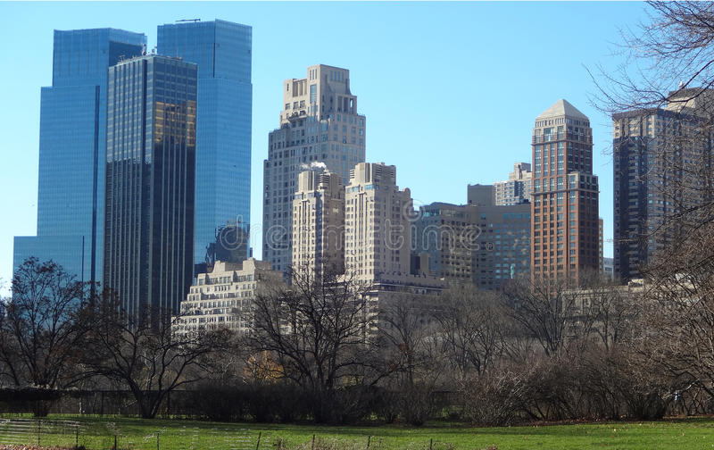 New York Skyline from Inside Central Park. A view of New York City from inside Central Park on a clear winter day royalty free stock photography