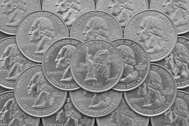 New York State and coins of USA. Pile of the US quarter coins with George Washington and on the top a quarter of New York State stock image