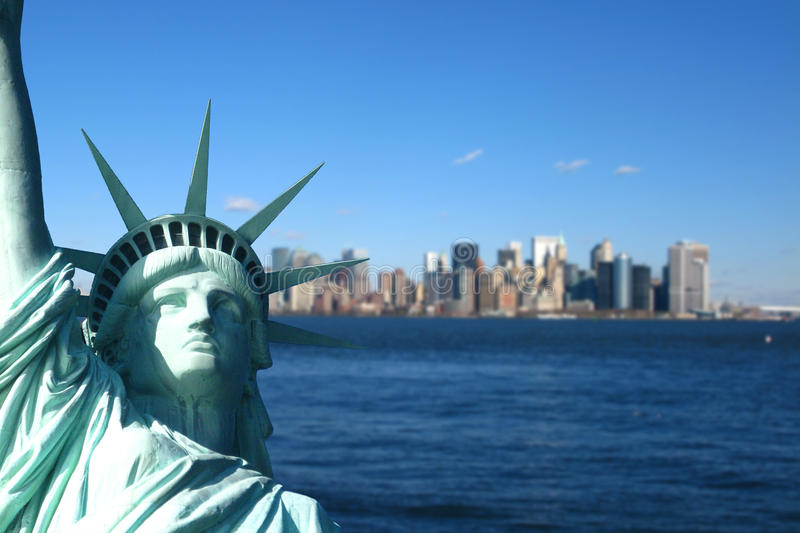 New York: The Statue of Liberty, with Lower Manhattan skyline royalty free stock image