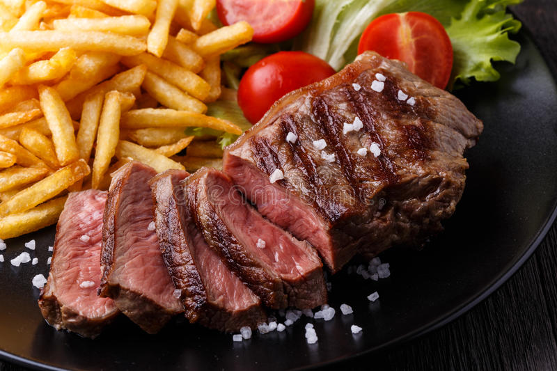 New York steak with french fries royalty free stock photography