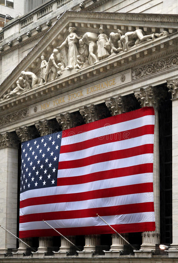 New York Stock Exchange. The flag-draped facade of the New York Stock Exchange building is one of the best known symbols of finance royalty free stock photography