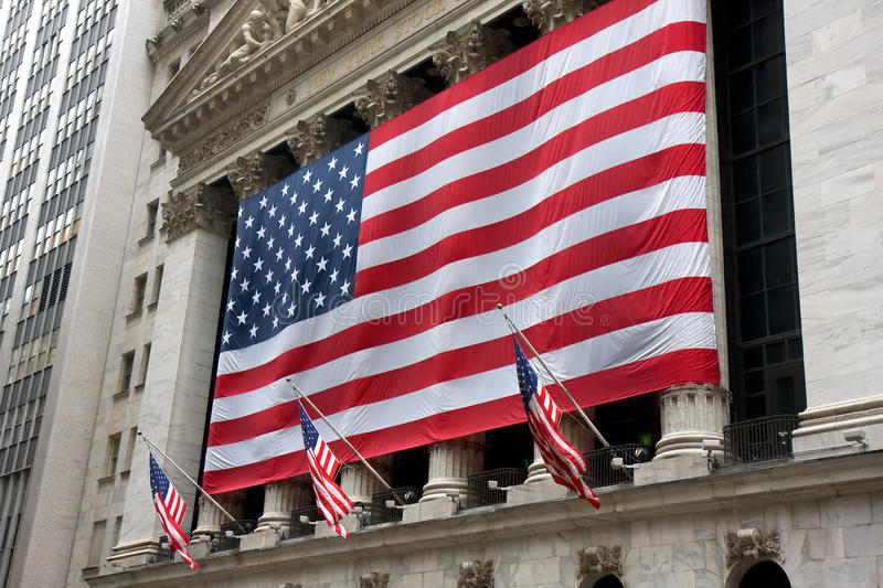New York Stock Exchange. The New York Stock Exchange with one large US flag and three small ones royalty free stock images