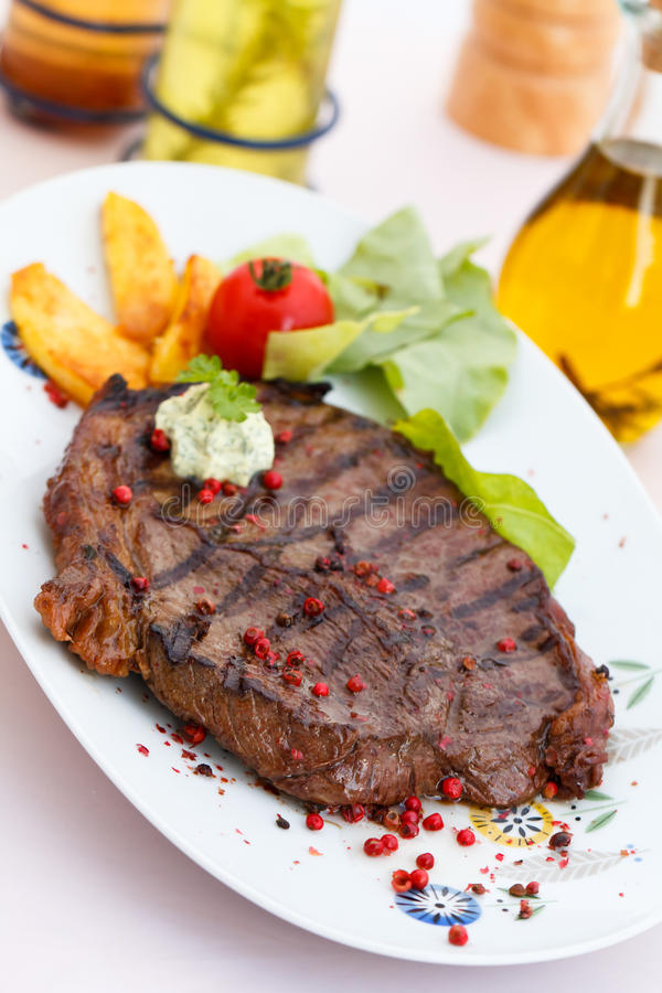 New York Strip Steak with Vegetables royalty free stock images