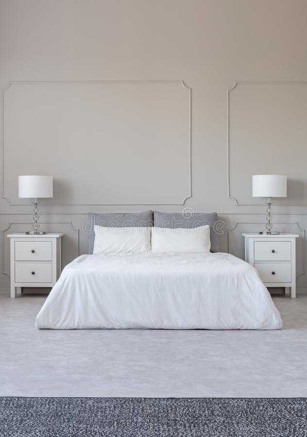 New york style bedroom interior with symmetric design, copy space on empty grey wall. New york style bedroom interior with symmetric design, copy space on empty stock photo