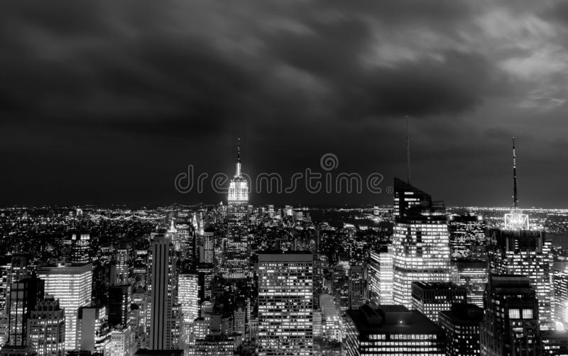 Sundown from the top of the rock - Empire State Building lit in the centre left of the frame - in black and white royalty free stock images