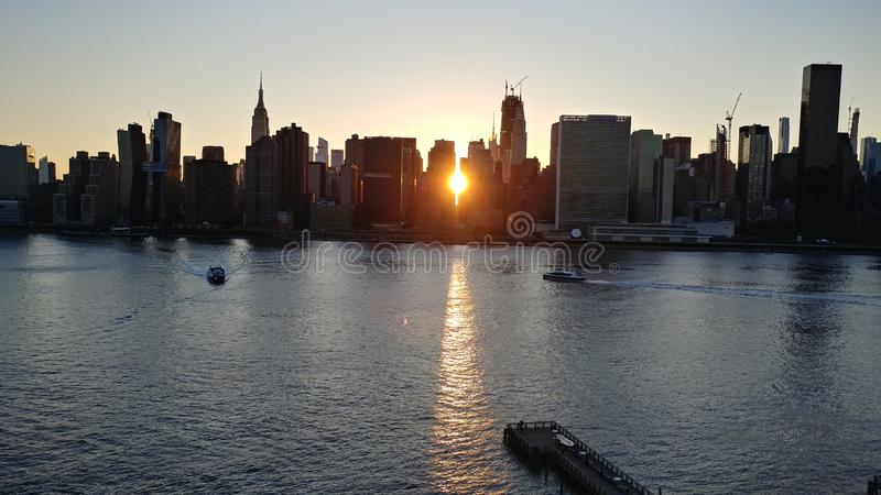 New York sunset between the buildings in Manhattan royalty free stock photography