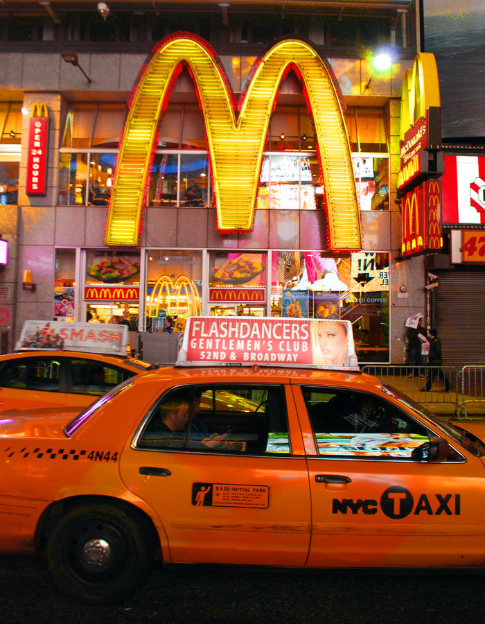 New York taxi in front of McDonalds royalty free stock photo