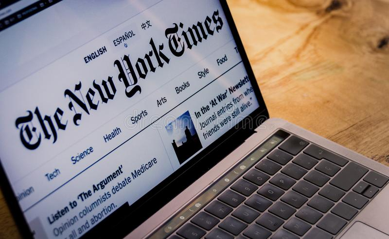 The New York Times landing page on laptop screen stock images