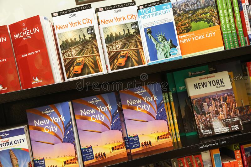 New York tourist guides on bookshelves royalty free stock photo