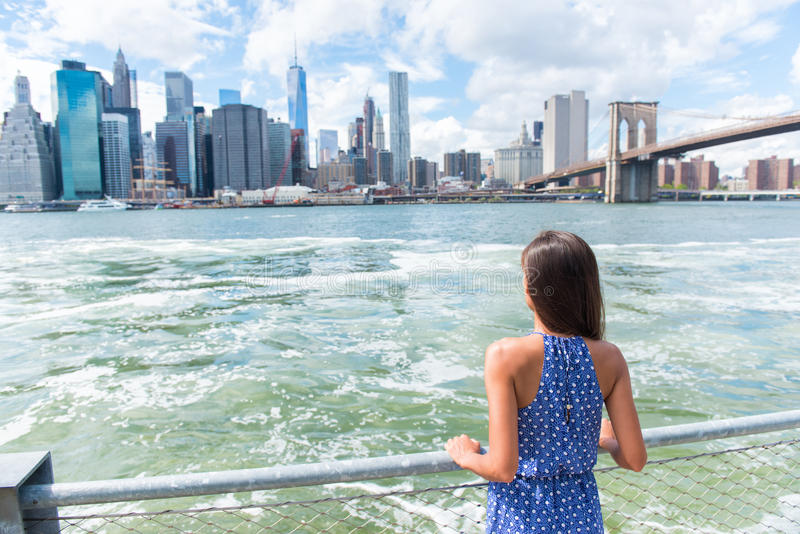 New York tourist looking at Manhattan skyline view. New York city urban woman enjoying view of downtown Manhattan skyline from Brooklyn park living a happy stock image