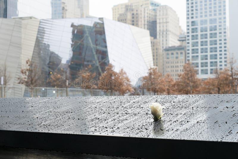 NEW YORK, US - NOVEMBER 22: Rose on 9/11 memorial memorial commemorating the victims of terrorist attacks. November 22, 2013 in N. Ew York royalty free stock images