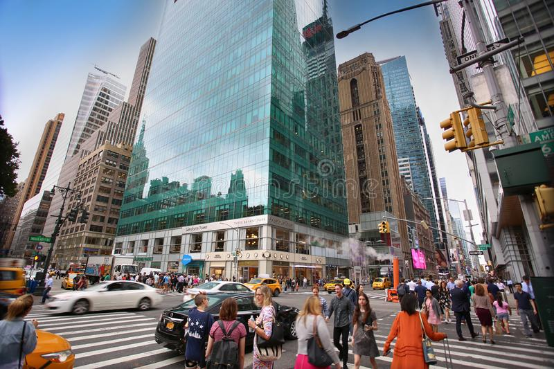 New York, USA – August 20, 2018: Busy sidewalk at the intersection 6th Avenue and 42nd Street near at Bryant Park with traffic royalty free stock photos