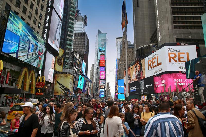 New York, USA – August 20, 2018: Crowded with many people walk. Ing Times Square with huge number of LED signs, is a symbol of New York City in Manhattan royalty free stock photo