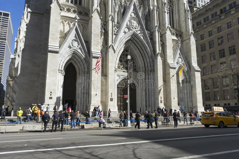 St. Patrick`s Cathedral in Manhattan, NYC. NEW YORK, USA - April 26,2018 : Crowded of tourist in front of St. Patrick`s Cathedral on 5th avenue in Manhattan, NYC stock photo