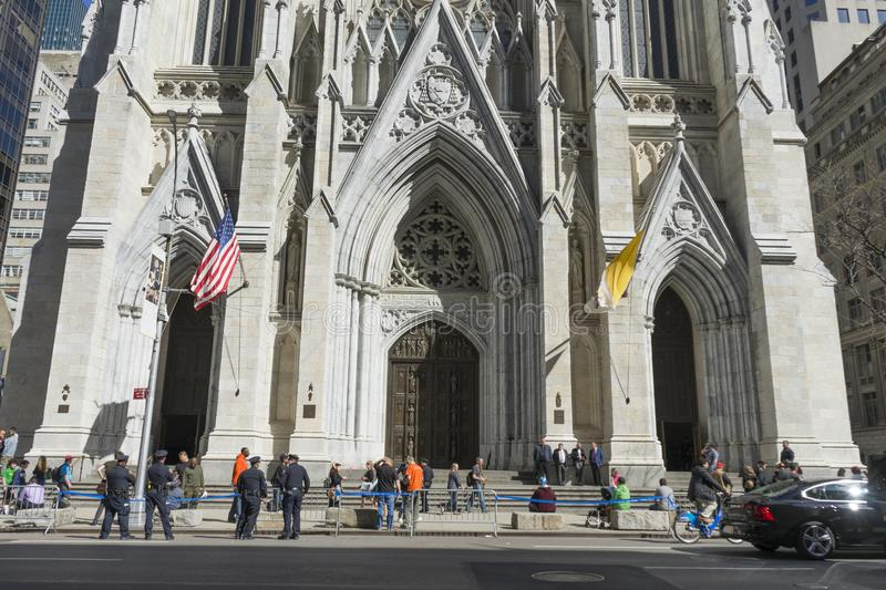 St. Patrick`s Cathedral in Manhattan, NYC. NEW YORK, USA - April 26,2018 : Crowded of tourist in front of St. Patrick`s Cathedral on 5th avenue in Manhattan, NYC royalty free stock photos