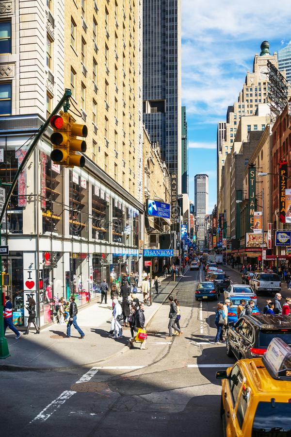 West 44th Street and Majestic Theater in Midtown Manhattan NYC. New York, USA - April 26, 2015: Intersection of West 44th Street and 8th Avenue, and Majestic stock photography