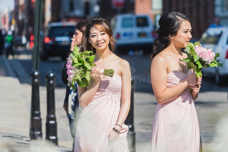 NEW YORK, USA - APRIL 28, 2018: Two bridesmaids standing in streets of Dumbo, Brooklyn, New York. USA stock photo