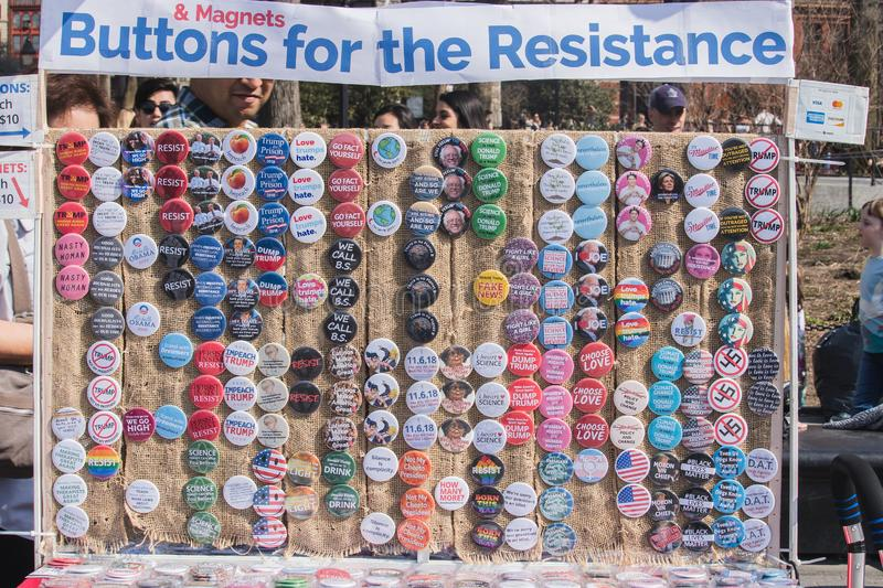 NEW YORK, USA - APRIL 14, 2018: A vendor selling anti-Trump political buttons in a park in New York City, stock images
