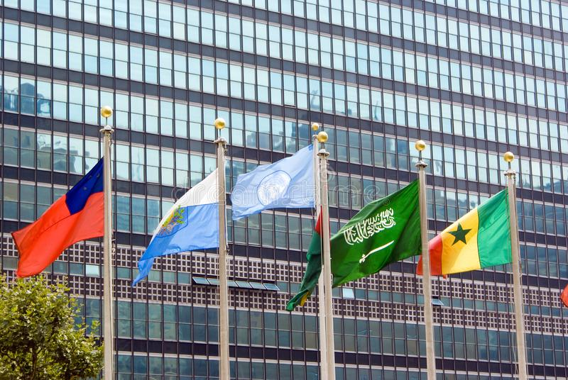 New york, usa- August 15, 2008: Flag of the UN and other countries waving in front of the official headquarters building stock image