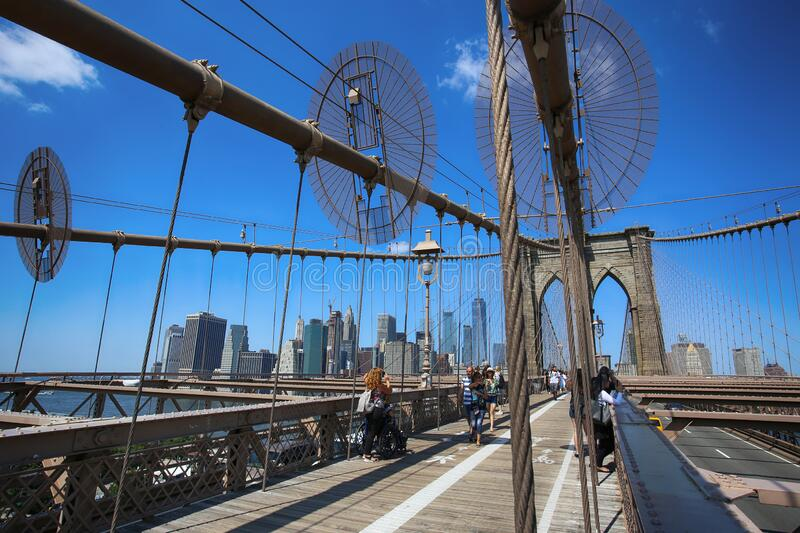 New York, USA – August 23, 2018: People on pedestrian walkway on the Brooklyn Bridge, this bridge connects Manhattan and stock images