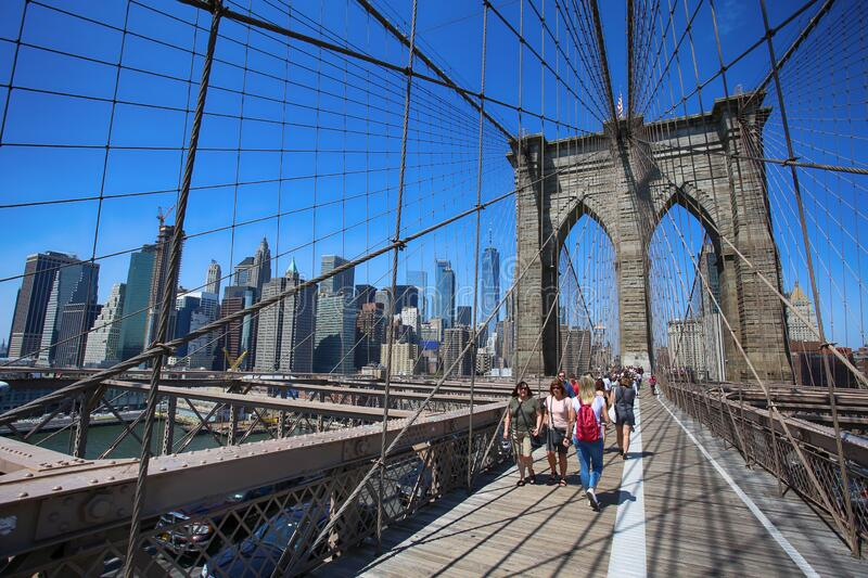 New York, USA – August 23, 2018: People on pedestrian walkway on the Brooklyn Bridge, this bridge connects Manhattan and stock photography