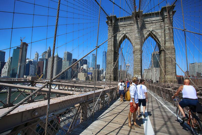 New York, USA August 23, 2018: People on pedestrian walkway on the Brooklyn Bridge, this bridge connects Manhattan and stock photography