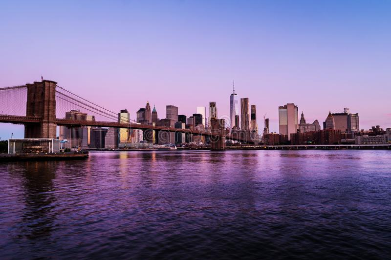View of Brooklyn bridge and Manhattan in New York, USA in the morning stock photography